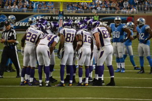 Football Offense in Huddle