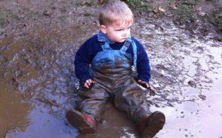 Boy wearing muddy clothes